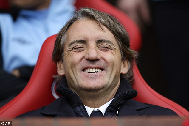 Game for a laugh: City manager Roberto Mancini enjoys his side's thrilling performance