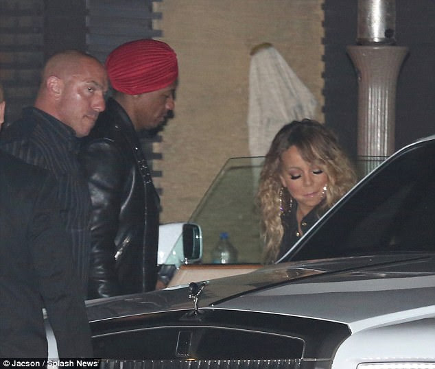 Slick: Nick also looked trendy in a black biker jacket and bright red turban as he hopped into an awaiting vehicle with his glam ex