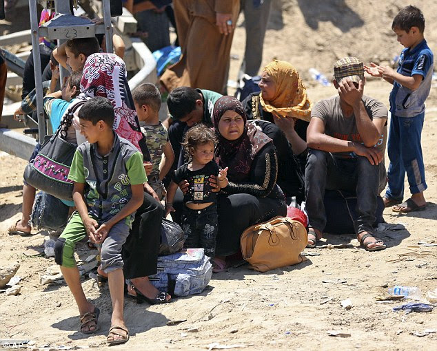 Escape: Thousands of civilians who fled Ramadi have 'nowhere to run, nowhere to hide,' Human Rights Watch told MailOnline