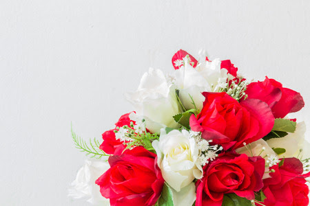 red roses and white roses artificial on a white background with space for text input. Stock Photo - 36805826