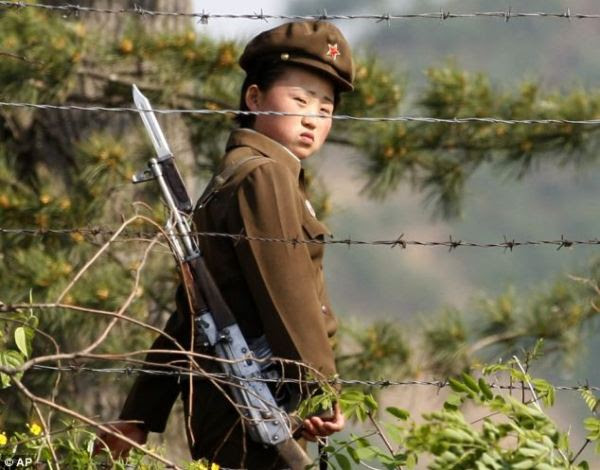 Photo is of a North Korean female soldier guarding a prison camp.
