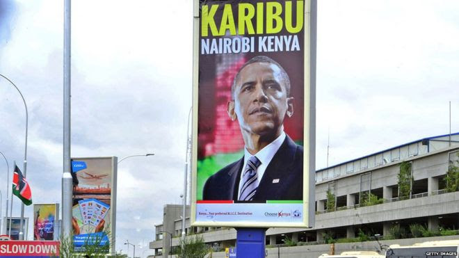 A banner bearing the likeness of the President of the United States, Barack Obama and bearing a 'welcome' message hangs over the arrival lounge of the Kenya's Jomo Kenyatta airport in Nairobi on July 23, 2015
