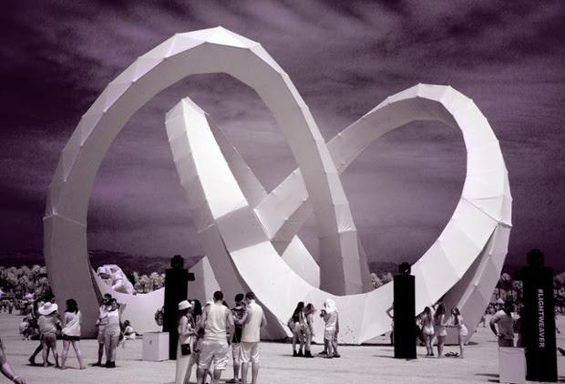 Revellers admire Lightweave, an art installation by Alexis Rochas