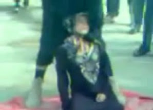 In Syria ISIS fighter strangles a little girl to death for violating Sharia law, in a public execution where her parents were forced to watch.