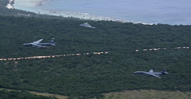 A U.S. Air Force B-52 Stratofortress, B-1 Lancer and B-2 Spirit fly over Guam after launching from Andersen Air Force Base, Guam, for an integrated bomber operation Aug.17, 2016. This mission marks the first time in history that all three of Air Force Global Strike Command's strategic bomber aircraft are simultaneously conducting integrated operations in the U.S. Pacific Command area of operations. As of Aug. 15, the B-1 Lancer will be temporarily deployed to Guam in support of U.S. Pacific Command's Continuous Bomber Presence mission. (U.S. Air Force photo by Senior Airman Joshua Smoot)