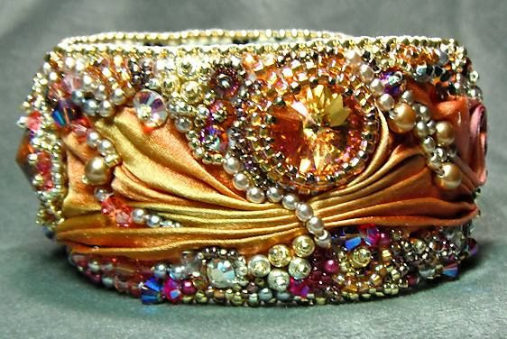 "~~""Aurora's Jewels"" is the name of this silk and bead embroidery bracelet by Gail Nettles~she named it this because the colors made her think of the sunrise...and Aurora is the goddess of the dawn in Roman mythology~~"
