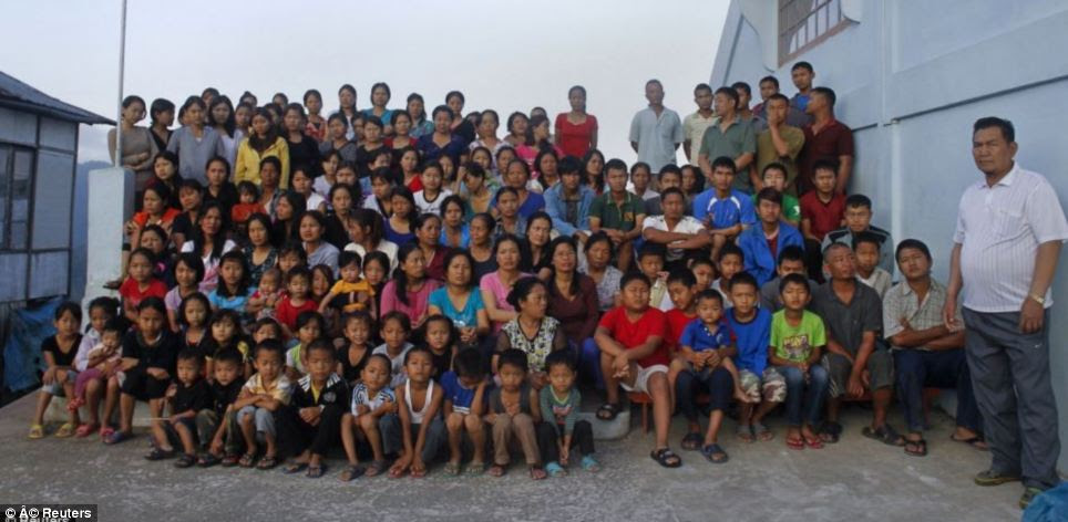 Mr Chana lives with his huge family, pictured, in a 100-room, four-storey house in the village of Baktawng, Mizoram