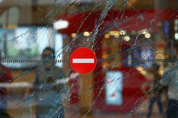 A broken window is seen at Turkey's largest airport, Istanbul Ataturk, Turkey