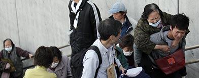 Evacuees from Futaba, Fukushima Prefecture, arrive at their new evacuation shelter at Saitama Super Arena in Saitama, northern Tokyo, Japan Saturday, March 19, 2011. (AP Photo/Eugene Hoshiko)