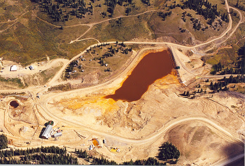 Acid drainage in containment pond at base of Summitville Superfund site