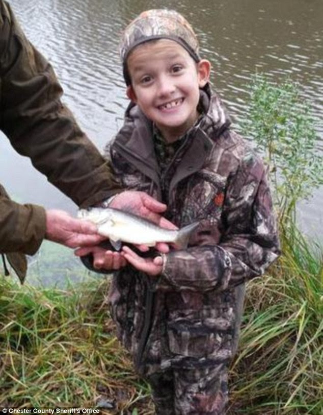 Alex didn't bag a big buck - but he did catch a bass at one of Sheriff Underwood's favorite fishing spot