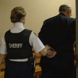Former N.L. politician Jim Walsh is led out of a St. John's courtroom in handcuffs after being sentenced to 22 months on fraud-related crimes.