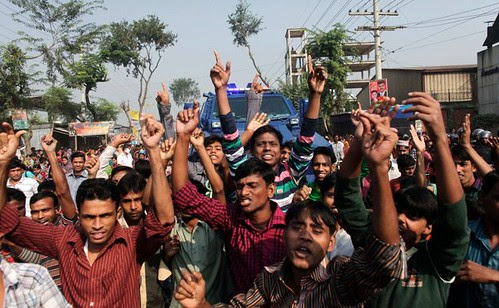 Bangladesh factory workers demonstrate against the conditions that lead to a deadly fire that killed over 100 people. The country is a center of garment production. by Pan-African News Wire File Photos