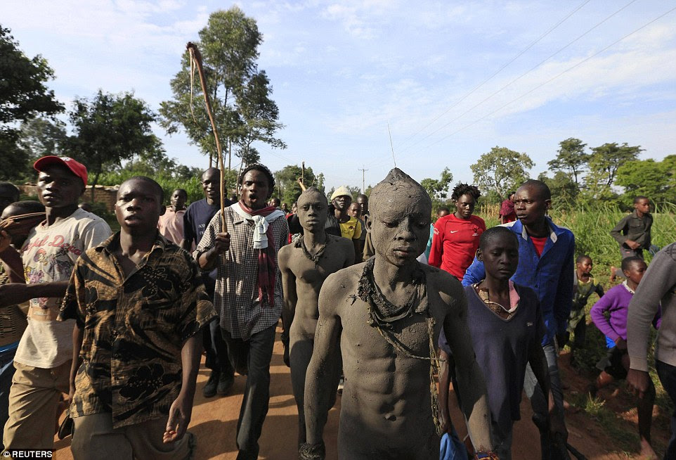 Once the mud is dry, the boys are paraded through the streets of the village before the entire community before they are finally cut with everyone watching