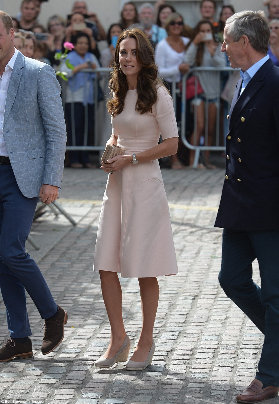 The Duchess looked the picture of elegance in a pale pink dress by Lela Rose as she arrived in Cornwall with William this morning