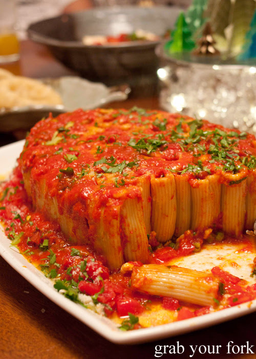 Timballo pasta tubes stuffed with mini meat balls, boiled eggs and peas in a homemade tomato sauce from locally grown tomatoes