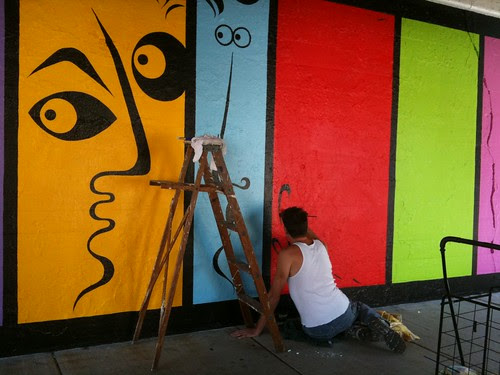 Artist working on his mural, Rogers Park
