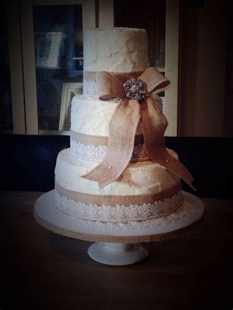 Rustic vintage themed wedding cake. Three tiers covered in
