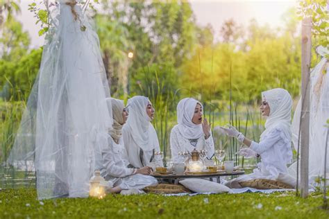 4 Women in White Abaya Wedding Gown Having Picnic Near