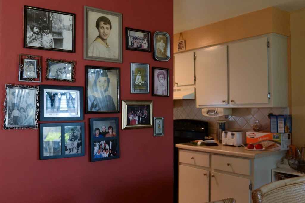 Photos of family and relatives cover the walls of the Knights' dining room. Photo by Ariel Min/PBS NewsHour
