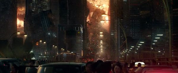 A crowd of people run away as surrounding buildings are lifted into the air by an anti-gravity device being used by an alien spacecraft hovering overhead in INDEPENDENCE DAY: RESURGENCE.