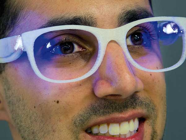 Troy Hudson, 22, a senior at Drexel University, models his Lumiware therapy glasses for people with seasonal affect disorder. Hudson´s hometown is Runnemede, NJ.  Photo taken May 27, 2014 at Drexel´s URBN Center.  ( CLEM MURRAY / Staff Photographer )