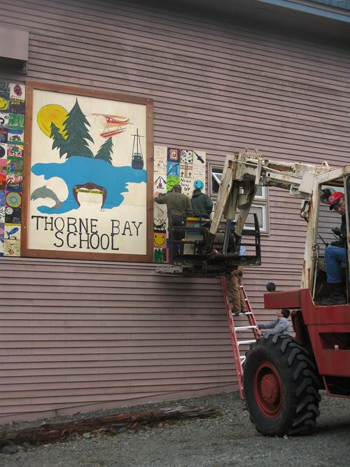 installing new signage at Thorne Bay School, Thorne Bay, Alaska