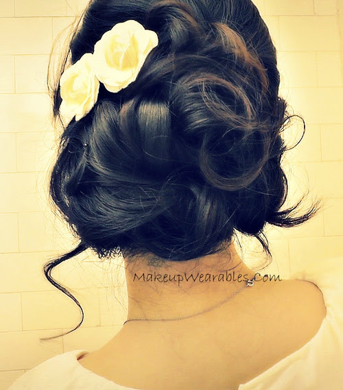 curly homecoming updo for thick hair