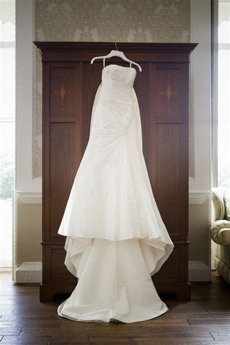 Wedding dress hanging up with wardrobe   Wedding pictures