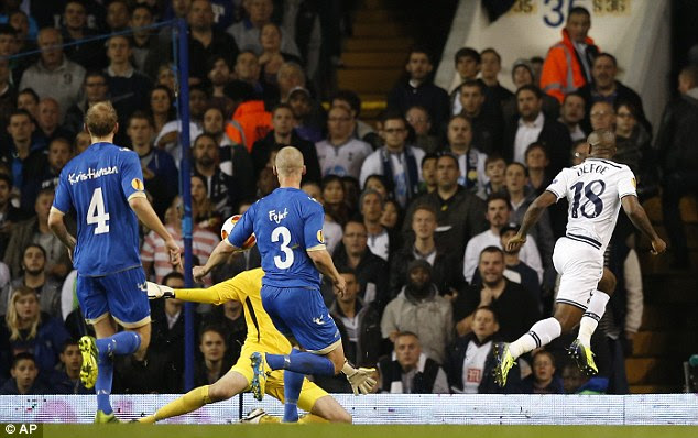 Cool finish: Defoe puts his shotpast Tromso's goalkeeper Marcus Sahlman for the opening goal