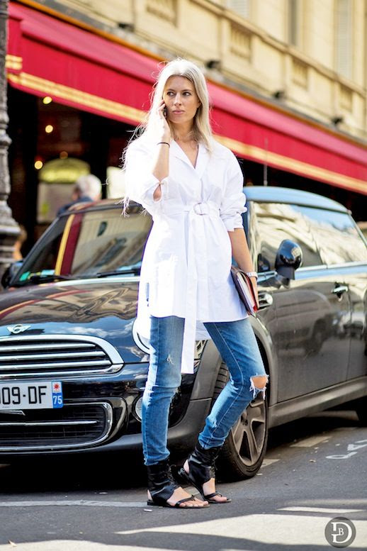 Le Fashion Blog Street Style Sarah Harris Elevated Casual Look Belted Tie Front White Shirtdress Ripped Skinny Jeans Black Ankle Wrap Sandals Via The Urban Spotter