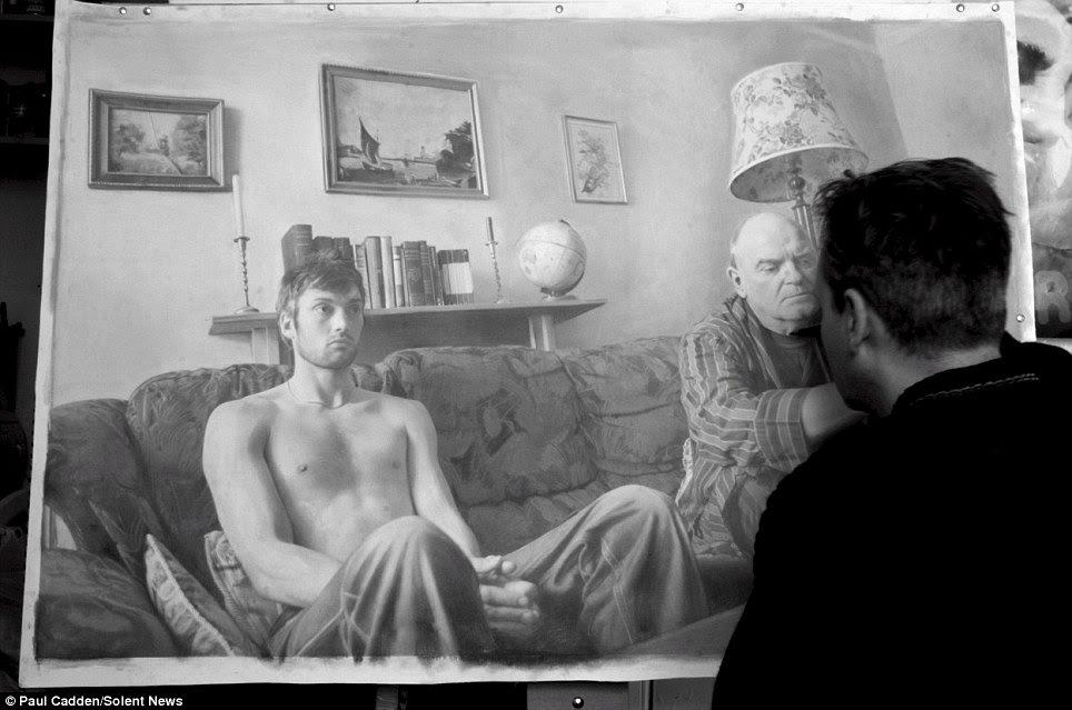 Art in action: Paul Cadden is seen working on one of his pieces. The artist specialises in hyperrealism - a form of detailed drawing that it so lifelike it could be mistaken for a photograph