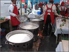 23 boiling noodles in huge pots