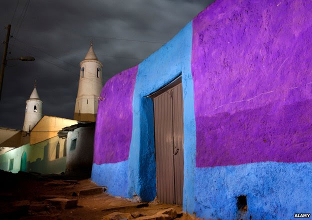 Brightly coloured wall and mosque in Harar