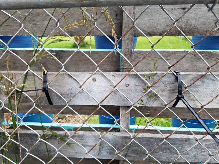 heavy duty zip ties hold pallet to chain link fence