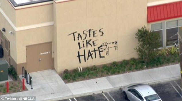 Graffiti: Vandals at a Chick-fil-A in Torrance left a message on the restaurant on Friday during a week of protests in response to the company president's comments regarding same-sex marriage