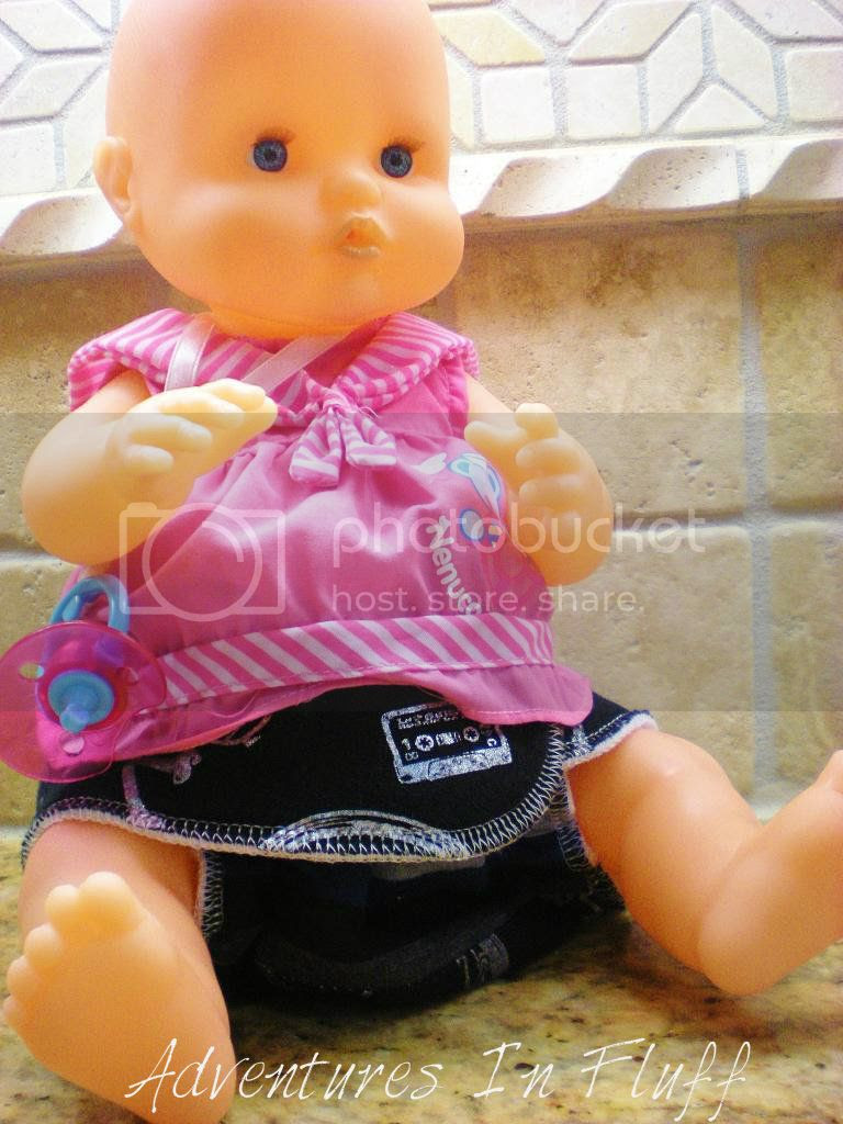 Nenuco Newborn Baby Doll with a cloth diaper on