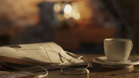 Shot Of Coffee Cup And Newspaper On Table 4K by