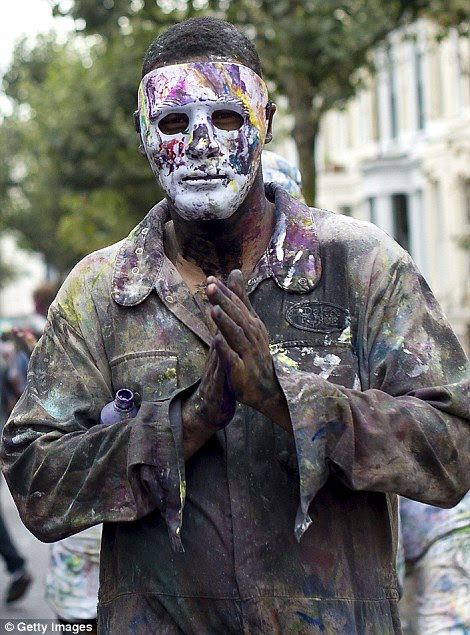 Another man preferred some face protection from the paint fights