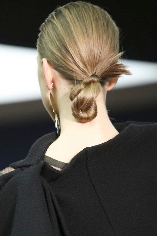 LE FASHION BLOG HAIR INSPIRATION TWISTED CHIGNON CELINE FW 2014 SLICKED BACK LOW TWIST BUN ONE STATEMENT EARRING PARIS FASHION WEEK 4 photo LEFASHIONBLOGHAIRINSPIRATIONTWISTEDCHIGNONCELINEFW20144.jpg