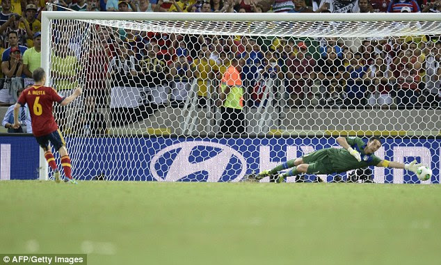 Held his nerve: midfielder Andres Iniesta slotted his penalty past Buffon in the Italian goal