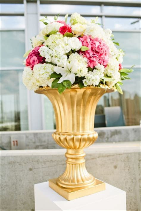 white columns, gold urn, fill with all white flowers for