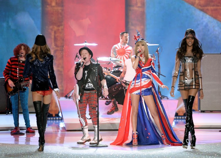 Musicians Joe Trohman, Patrick Stump, Andy Hurley, and Pete Wentz of the band Fall Out Boy and Taylor Swift perform and models Kasi Struss and Cindy Bruna walk the runway at the 2013 Victoria's Secret Fashion Show at Lexington Avenue Armory on November 13, 2013 in New York City. (Dimitrios Kambouris/Getty Images)