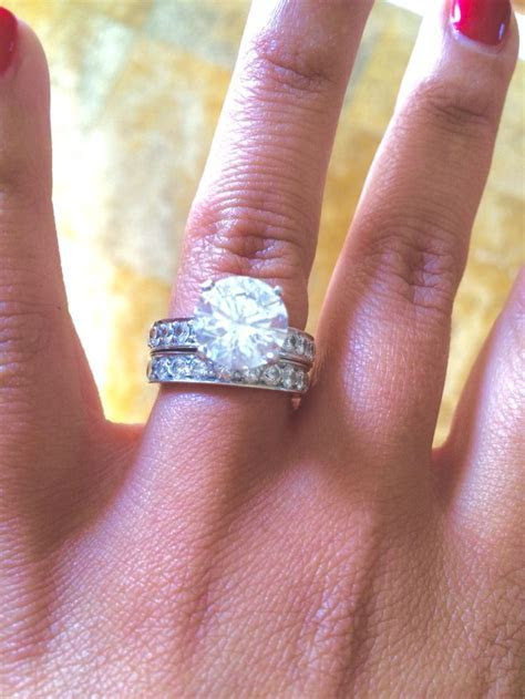 4ct round diamond engagement ring in a 4 prong setting