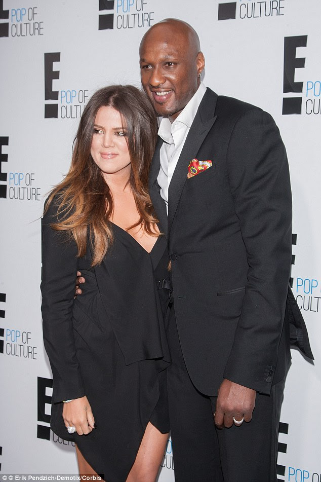 Former couple: The reality star and the basketball pro withdrew divorce papers so that Khloe could make medical decisions on Lamar's behalf, but they are not back together. They are seen here in 2012