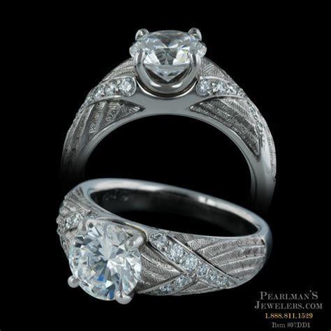 Elegant platinum Venti engagement ring from Michael Bondan..
