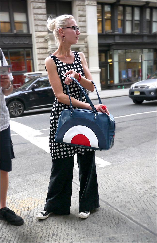 1x 10w black and white polka dot sleeveless dress over black slacks red white and blue target bag black converse allstars ol