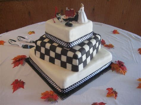 Race car theme wedding cake.   She wanted the checkered