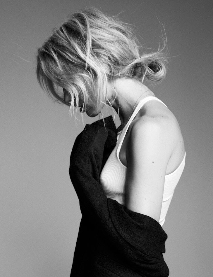Le Fashion Blog Hair Inspiration Elin Kling Textured Wavy Low Bun Messy Up Do White Tank Top Via Cover Magazine