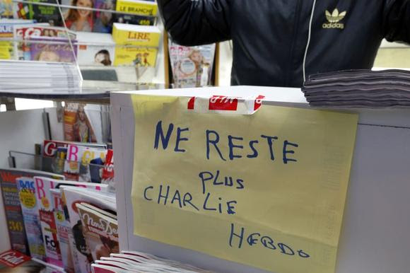 A handwritten sign at a newsstand, which reads ''No more Charlie Hebdo'', is displayed after it sold out the limited stock of the satirical newspaper in Paris January 14, 2015.  REUTERS/John Schults